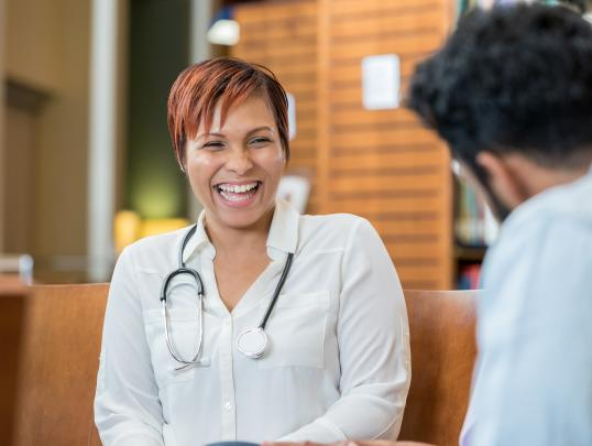 Doctor smiling with talking to someone